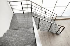 Free Stone Stairs With Metal Railing Indoors Royalty Free Stock Images - 113765659