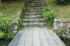 Stone stairs. And wooden walkway in the wild stock photos
