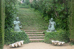 Stone stairway with bush in garden. Stone stairway with couple statue bush in garden Royalty Free Stock Images