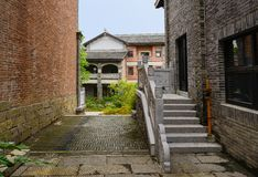 Stone stairway at side door of old-fashioned building in cloudy. Stone stairway at the side door of an old-fashioned building in cloudy afternoon,Qingyan town stock images