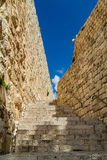 Stone stairway between stone walls Stock Images