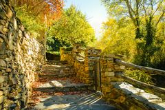 Stone stairway and wall in autumn among trees in Umbralejo Guadalajara stock photo