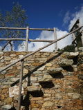 Stone stairway with wooden railing and fence Stock Image
