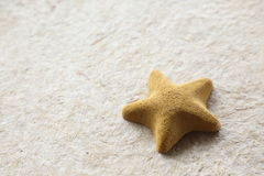 Stone starfish  on mulberry paper texture Royalty Free Stock Image