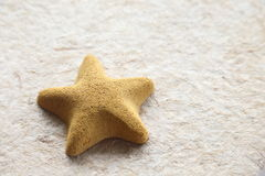 Stone starfish  on mulberry paper texture Stock Image