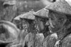 Stone statuary of vietnamese farmers stock image