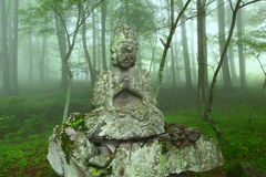 Stone statue. In the mist, japan Stock Photos