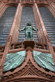 Stone statue. Looking up at statue carved in stone on Liverpool  cathedral Royalty Free Stock Photos