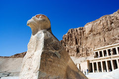 A stone statue. A god stone statue in front of Mortuary Temple of Hatshepsut Stock Photo