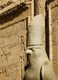 A stone statue. A god stone statue in front of Edfu Temple Stock Photography