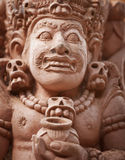 Stone statue of an ancient deity. Indonesia, Bali Royalty Free Stock Images