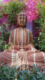 Stone Statue of Buddha in Garden Stock Photography