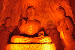 Stone statue of Buddha in Longmen Grottoes. The Longmen Grottoes, in the china-Luoyang city's Dragon Gate mountainpass place, are apart from the urban district Royalty Free Stock Photos