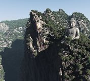 A stone statue of Buddha in the mountains Stock Photos