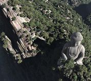 A stone statue of Buddha in the mountains Royalty Free Stock Photography