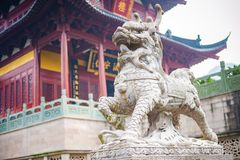 Stone statue of buddhist Guardian Lion royalty free stock image