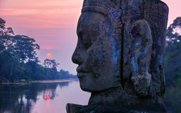 Stone statue on causeway near Gate of Angkor Thom in Siem Reap, royalty free stock photos