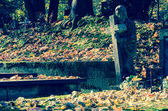Stone statue in the cemetery Royalty Free Stock Images