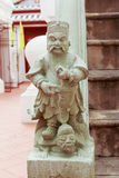 Stone statue of Chinese god in public temple Stock Photography