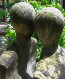 A Stone Statue of a Couple Looking Fondly Into Each Others Eyes stock photo
