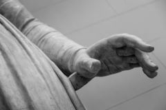 Stone statue detail of human hand stock images