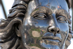 Stone statue face. Closeup of a sculptured, stone face Stock Photos