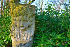 Stone statue of a face of a child Royalty Free Stock Photo