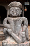 Stone statue of a fighter guardian at Nyatapola Hindu temple Stock Images