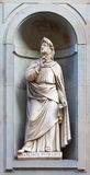 Stone statue of Francesco Petrarca. Stone statue depicting historical character Stock Photo