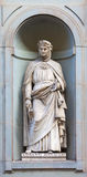 Stone statue of Giovanni Boccaccio. Stone statue depicting historical character Stock Images