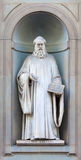 Stone statue of Guido Aretino. Stone statue depicting historical character Stock Images