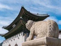 Stone Statue of Haetae Guardian Dog and Gwanghwamun Gate Stock Photography