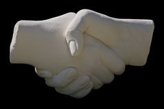 Stone statue handshake Stock Photos