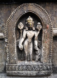 Stone statue of a Hindu God on a public temple Royalty Free Stock Images