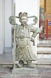 Stone statue hold lancer at Wat Pho. Stone statue hold lancer stand on entrance at Wat Pho Stock Photo