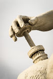 Stone Statue Human Hand and Industrial Cog Stock Images