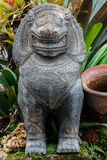 Stone statue of a lion-like creature in Thailand Royalty Free Stock Photos