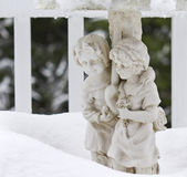 Stone Statue Lovers in the Snow Stock Photo