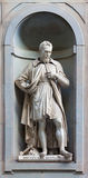 Stone statue of Michelangelo Buonarroti. Stone statue depicting historical character Royalty Free Stock Photo