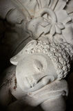 The stone statue of a reclining Buddha in Ubud, Bali, Indonesia Stock Photos