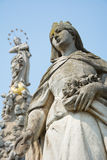 Stone statue of Saint Elizabeth. One of the stone statutes surrounding the Immaculate (plague column) on Main street in Košice (Cassovia). Elizabeth (of Hungary Stock Photo