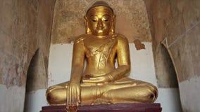 Stone statue of a sitting Buddha close up. Bagan, Burma Royalty Free Stock Photography