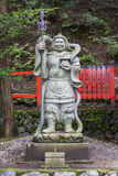 Stone statue of a warrior at a shinto shrine in Arashiyama dist Stock Photos