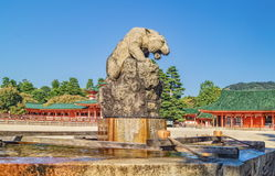 Stone statue of White Tiger over water basin at Heian Shrine Heian Jingu in Kyoto, Japan Stock Photography