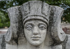 Stone statue of a woman with the face of the pharaoh Royalty Free Stock Photo