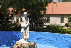 A stone statue of a woman with a jug, in a pool, National Reserve Askania-Nova, Ukraine. A stone statue of a woman with a jug, pool, National Reserve Askania Royalty Free Stock Photography