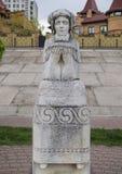 Stone statue of a woman prayer. In Ukraine Stock Photo