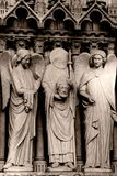 Stone statues. On the front porch of Notre-Dame cathedral - Paris, France stock photos