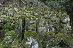 Stone statues of Buddha. The sculptures were donated in 1981 in honor of the refurbishment of the temple at Otagi nenbutsu-ji temple in Arashiyama Kyoto, Japan Stock Image