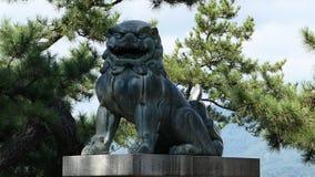 Stone statues of deified lion patron saint. Stone statues of deified lion patron saint in Japan Itsukushima Shrine Royalty Free Stock Photo